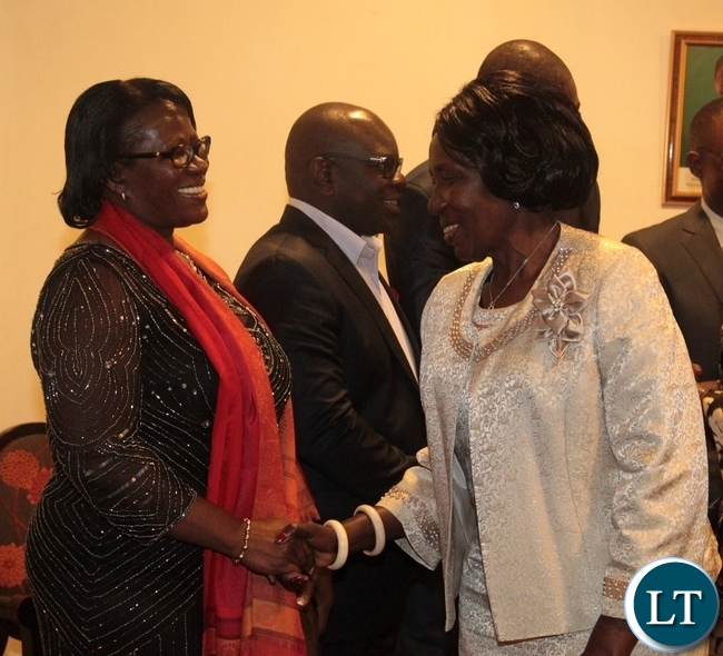 Vice President Inonge Wina(r) greets the High Commission of the Republic of Zambia  First Secretary Patricia Muyamwa(l) during the launch of the Zambian Chapter of Zambia-South Africa Business Council at Pamodzi Hotel in Lusaka