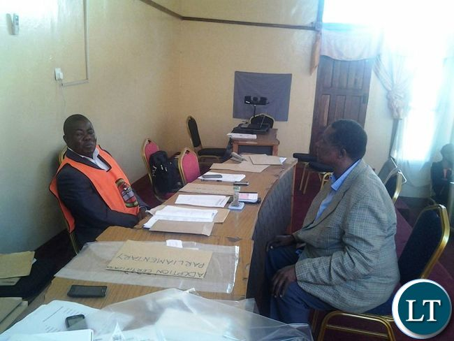 Forum for Democracy and Development(FDD) national chairperson Portipher Chungu explaining the predicament over who was the genuine candidate on mayoral elections between Mailess Phiri Mvula and Oswald Mphande to returning officer Samuel Phiri at Chipata Municipal Council Chamber