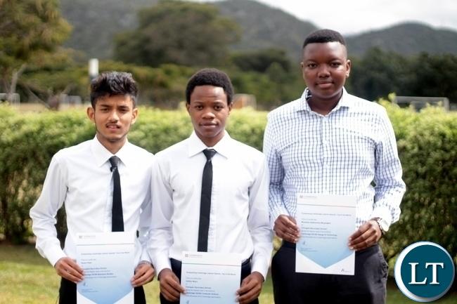 Karan, Dalitso and Munashe pose with their certificates