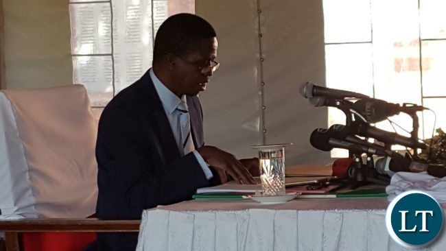 President Lungu reading through some documents during the news conference