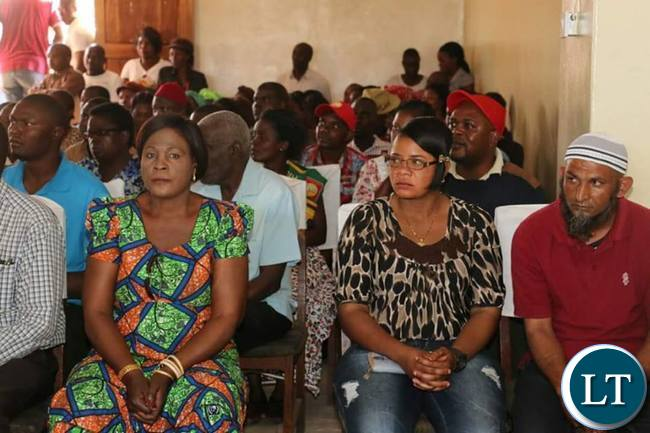 Some members of the Kanyama small business community  listening to HH