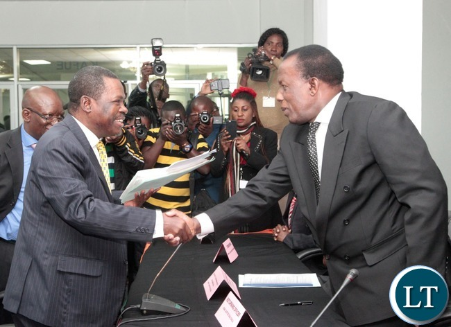 Rainball Party President Winter Kabimba(l) shakes hands with the Electoral commission of Zambia chairperson Essau Chulu(r)  during the Presidential Nominations at Mulungushi conference center