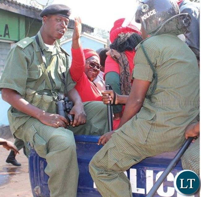 Ms Moono Lubezhi being whisked away after court appearance