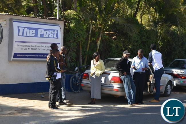 Post workers locked outside their offices on Bwinjimfumu road