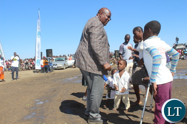 Southern Province Permanent Secretary Mr. Sibanze Simuchoba (right) joins people with disabilities as they entertained guests at the inaugural Samu Lya Moomba Lwiindi Traditional Ceremony held in Choongo chiefdom