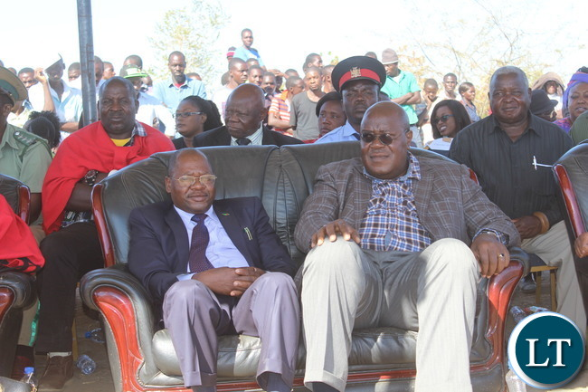 Mr. Hibene Mwiinga (seated left)special economic adviser to President Edgar Lungu,  and Southern Province Permanent Secretary Mr. Sibanze Simuchoba follow proceedings at the inaugural Samu Lya Moomba Lwiindi Traditional Ceremony held yesterday in Choongo chiefdom. Government helped in the construction of shelter, among other donations.