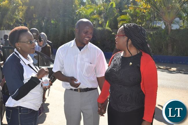 Some Post Newspapers workers managing a catch a light moment with MISA Zambia Chairperson Hellen Mwale