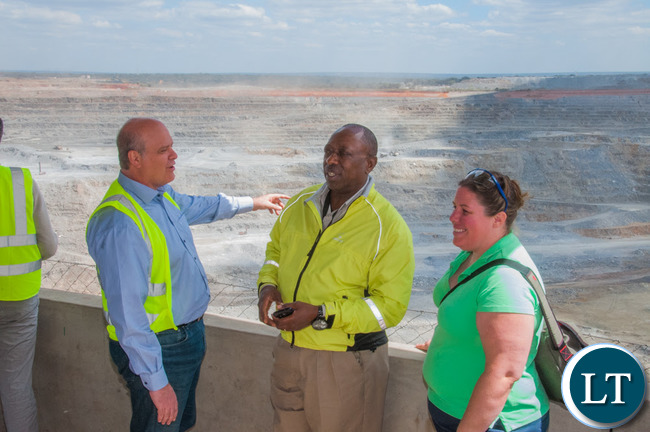 Head of the Office of the High Commission of Canada in Lusaka Amy Galigan, right, views First Quantum Minerals' Kansanshi mine with Kansanshi Public Relations Manager Godfrey Msiska (centre) and European Union Ambassador and Head of Delegation Alessandro Mariani.