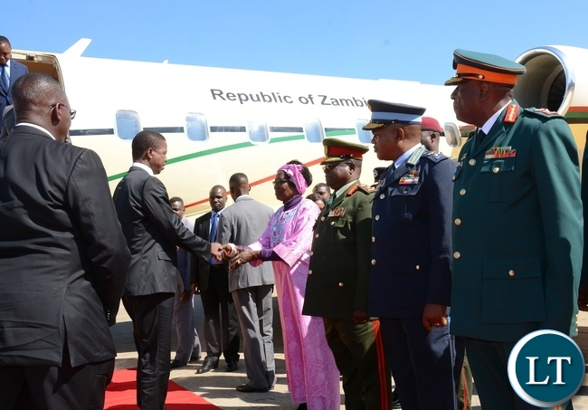 President Lungu shake hands with Vice President Inonge Wina during his arrival from Uganda at Kenneth Kaunda International Airport