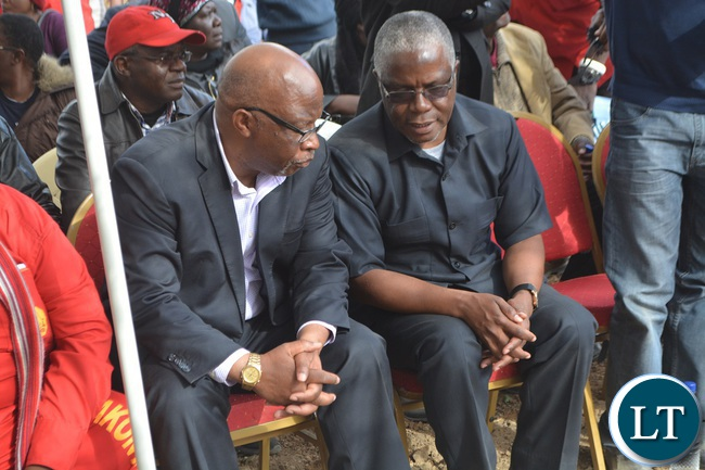 Southern Province Minister Nathaniel Mubukwanu chatting with MMD president Dr Nevers Mumba during the burial of former Kalomo Central Member of Parliament Request Muntanga in Kalomo,Southern Province