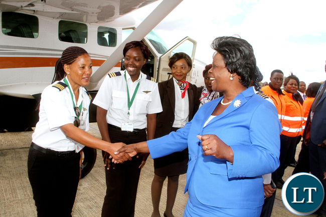 First Lady Esther Lungu with female pilots during the official Launch of Women in Aviation Zambia Chapter at Kenneth Kaunda International Airport on Thursday, July 14,2016 -Picture by THOMAS NSAMA