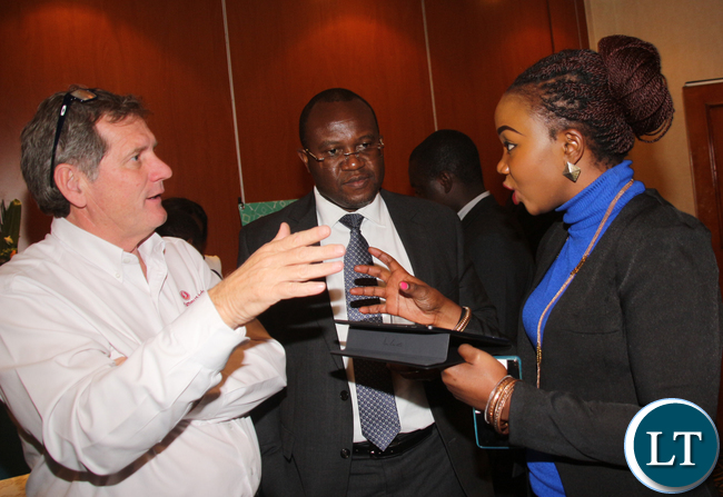 BARCLAYS BANK MD Saviour Chibiya following the explanation of Tigmoo spokesperson Namwezi Mukupa to Famous Brands MD Gareth Letherby.