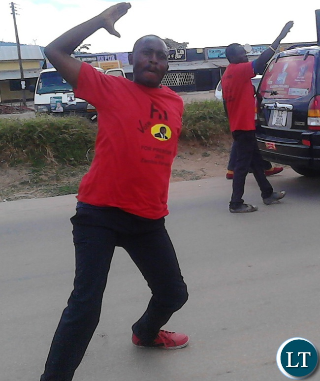 United Party for National Development (UPND) supporter flashes his party symbol during a procession to mobilize support for Serenje Central aspiring candidate Clarissa Chikamba the Serenje Central Business District (CBD) recently.