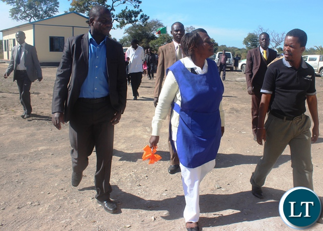 Central Province Minister Davies Chisopa with Chitakata A health Post Nurse in Charge Mercy Mwachingwala during the official hand over of a health post in Kabwe rural which is part of the 650 health posts Government is constructing across the country.