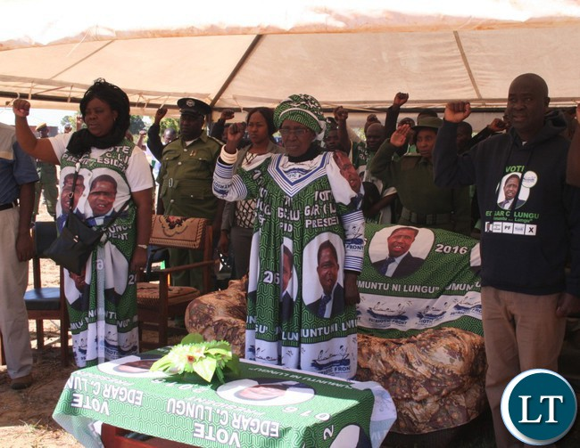 Vice –President Inonge Wina (m) with Tourism Minister Jean Kapata (l) and Kabompo West Patriotic Front candidate Daniel Kalenga singing the National Anthem at Mumbezhi school grounds
