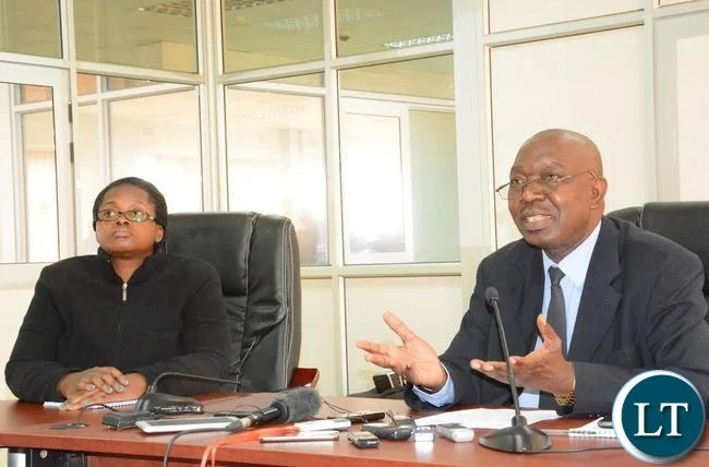 Public Relations Manager of Electoral commission of Zambia Crispin Akufuna (r) with Media Consultant for United Nation Program Silvia Namuju (L) during a press briefing at Electoral commission of Zambia(ECZ) offices