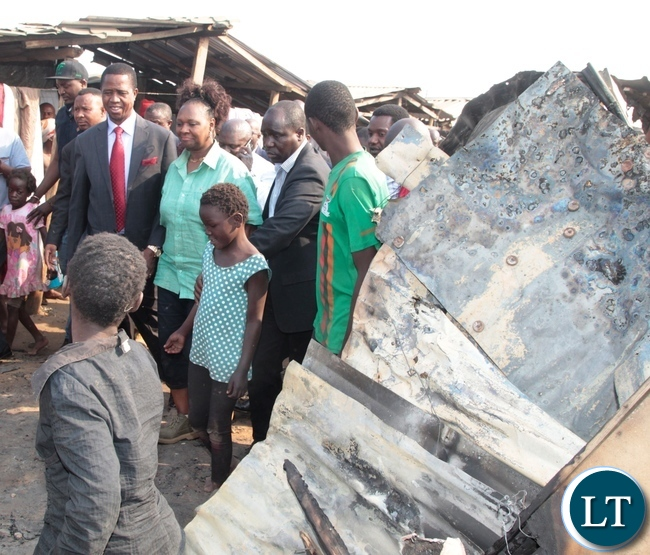 President Edgar Lungu and Lusaka Central MP Margaret Mwanakatwe inspects the burnt down shops at Bauleni Market