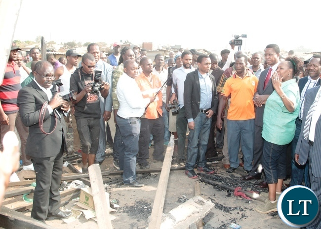 Lusaka Central MP Margaret Mwanakatwe explains to President Edgar Lungu on the burnt down shops at Bauleni Market