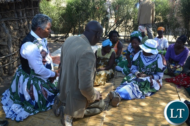 Vice President Inonge Wina (right) and Agriculture Minister Given Lubinda (left) consoling mourners in Simoonga Ward of Livingstone yesterday before she addressed a public rally in the area.