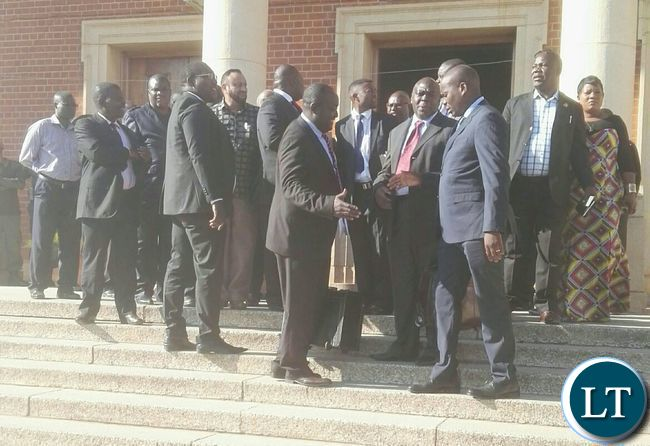 Lawyers shaking hands outside the Supreme Court