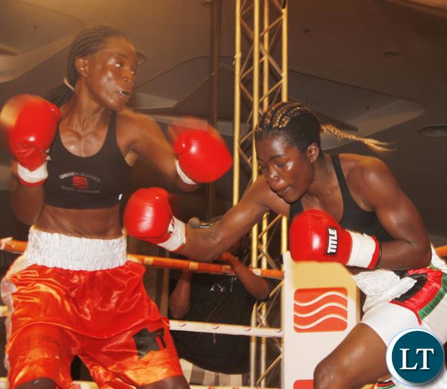 Zambia Lolita Muziya fighting Malawian lady boxer Anisha Bashit during the Welterweight not title fight bout, Lolita won the fight,