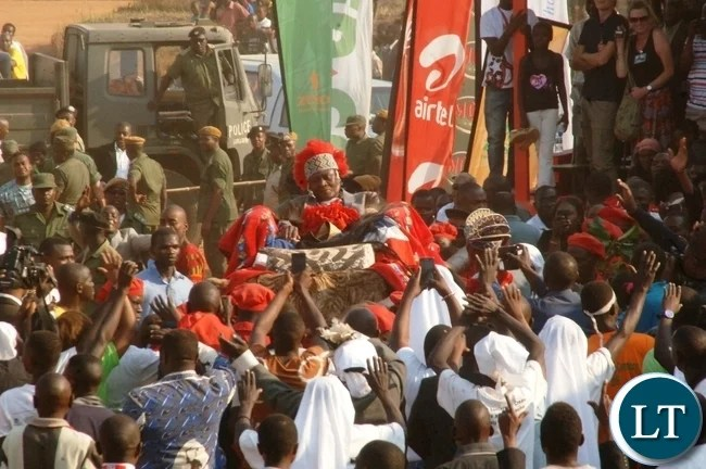 The Mwata is lifted on his Traditional Harmock on arrival at the main arena during the ceremony.