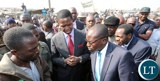 President Edgar Lungu with Amos Chanda and Kaizah Zulu tour Bauleni Market Burned
