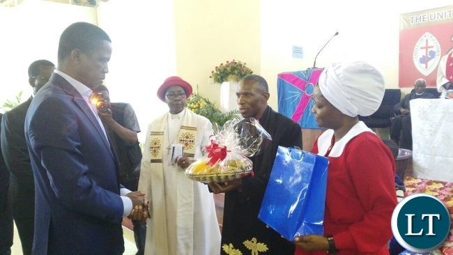 President elect Edgar Chagwa Lungu(left) receives a gift from Mrs.Ruby Sichilima at St. Andrews Congregation in Lusaka on Sunday,August 28,2016.PICTURE BY SALIM HENRY-STATE HOUSE ©2016
