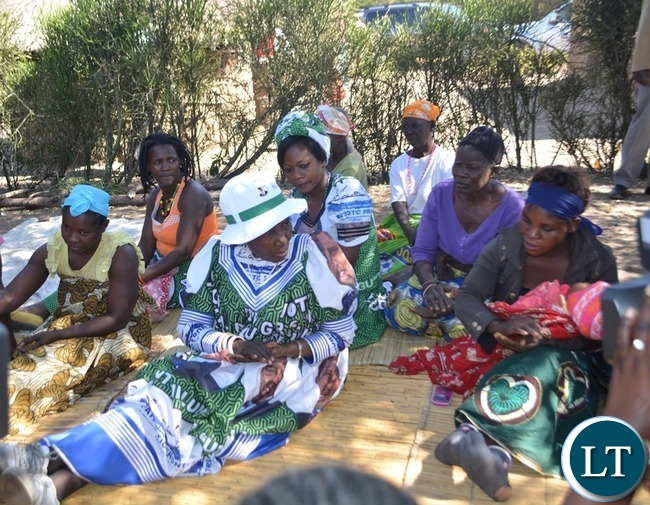 Vice President Inonge Wina (middle) consoling mourners in Simoonga Ward of Livingstone yesterday before she addressed a public rally in the area