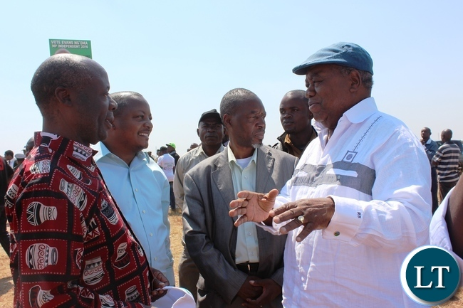 FORMER Republican President, Rupiah Banda, talks to Lundazi Central aspiring independent candidate, Bizwayo Nkunika, at Lundazi airstrip as they waited for President Edgar Lungu.