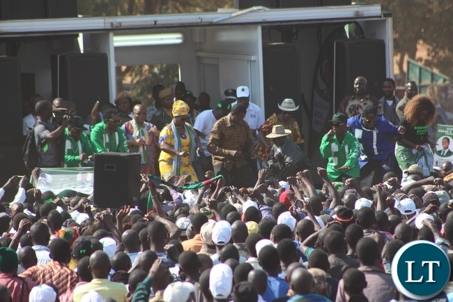 PRESIDENT Edgar Lungu, First Lady Esther and some musicians dance to the famous Dununa Reverse song shortly before the President addressed a rally at Market grounds in Lundazi