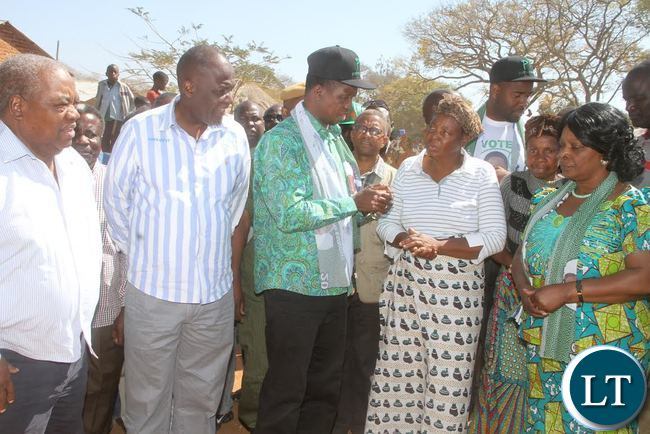 President Lungu talks to Paramount Chief Kalonga Gawa Undi's mother as First Lady Esther Lungu ,Former president Rupiah Banda and MMD president Felix Mutate listens after paying a Courtesy call on the Paramount  Chief at Mkaika Palace in Katete on Friday, August 5,2016 -Picture by THOMAS NSAMA