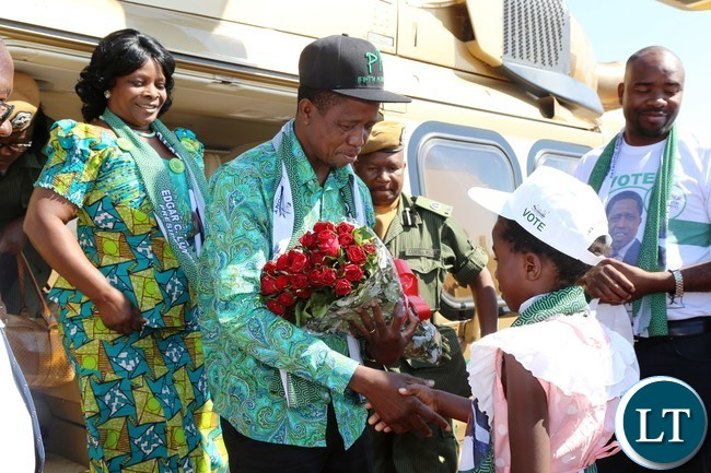,President Edgar Lungu being welcomed by an 8years old girl Ammanda banda on arrival at the palace of Paramount Chief Gawa Undi in katete District