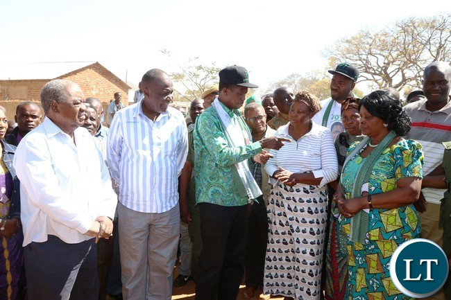 President Lungu talks to kalonga gawa undi's mother as First Lady Esther lungu listens after paying a courtesy call on the paramount in katete district
