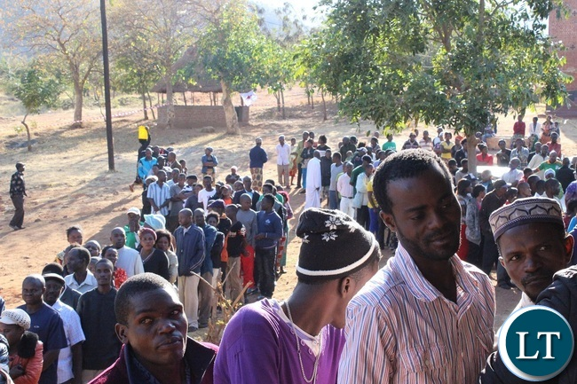 VOTERS voting at Mary Mother of God Parish in Chipata Central yesterday. Picture By JULIUS PHIRI