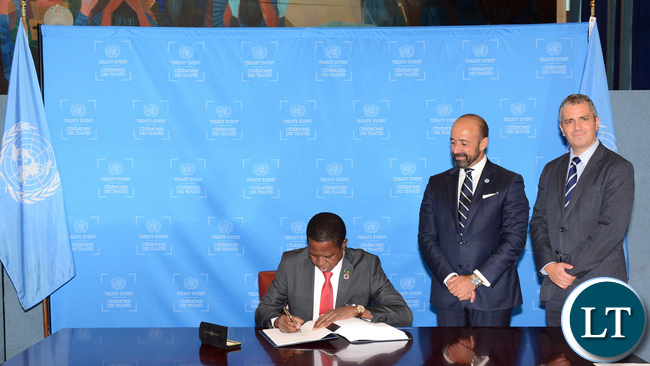President of Zambia His Excellency Mr. Edgar Chagwa Lungu signing the Paris Agreement on Climate Change during the UN Treaty Signing Event at the on-going High-Level Segment of the 71st Session of the United Nations General Assembly in New York USA on Tuesday 20 September 2016. Looking on is UN Under-Secretary-General for Legal Affairs and Legal Counsel Miguel de Serpa Soares (c) and UN Treaty Section Chief Santiago Villalpando (right). PHOTO | WIN KHINE | UN TREATY SECTION