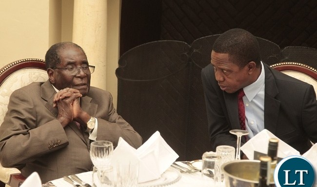 President Edgar Lungu with President Robert Mugabe at State House