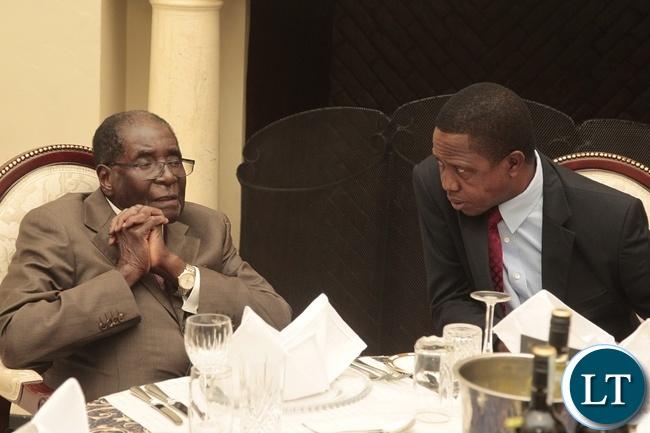 President Edgar Lungu with President Robert Mugabe at State House