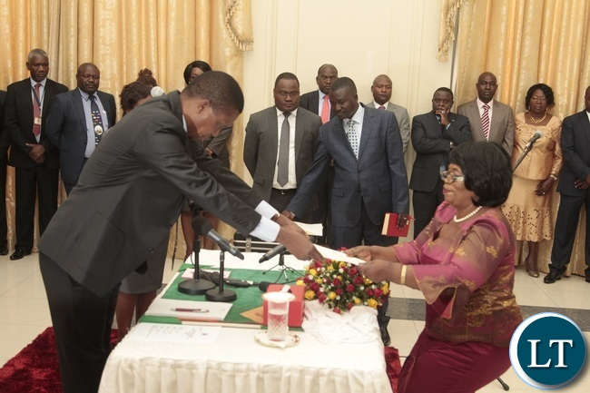 President Edgar Lungu receive latter of Oath from Newly appointed Minister of High education Nkandu Luo during swearing in ceremony at State House