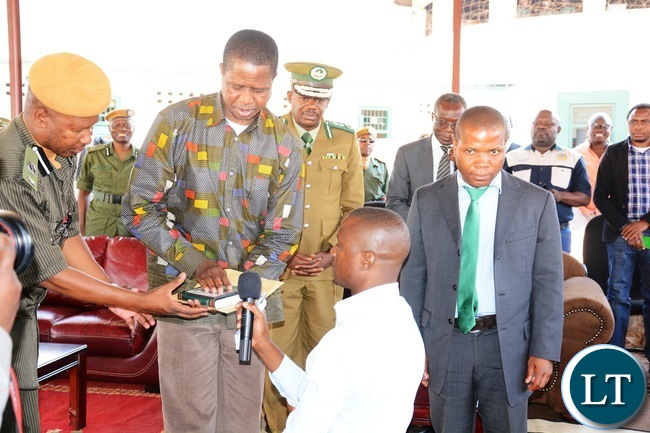 President Edgar Lungu recieves a bible and gospal CD from Zambia Correctional Services inmate representetive during the donation goods by President Lungu to the inmates