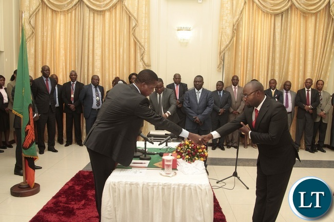 President Edgar Lungu congratulates Newly appointed Minister of Sports Moses Mawere during swearing in ceremony at State House