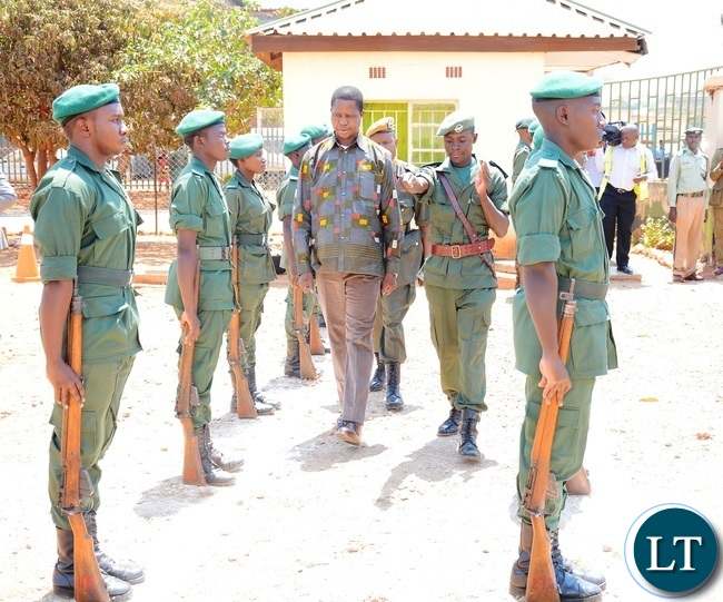 President Edgar Lungu inspects the guard of honour shortly before the donation of goods to the inmates