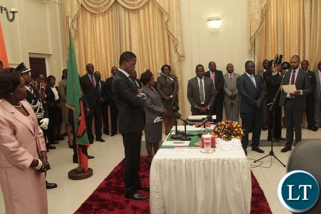 Newly appointed Minister of Local Government Vincent Mwale taking Oath before President Edgar Lungu and Vice President Inonge during swearing in ceremony at State House