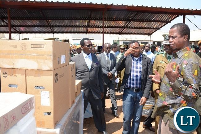President Edgar Lungu handing over computers to inmates during the donated goods