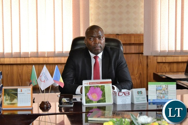 Copperbelt Province Minister Bowman Lusambo in his office on Friday