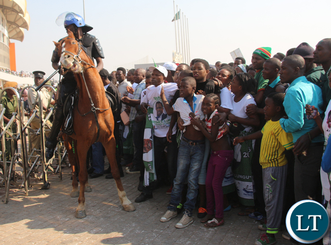 A ZP officer from mounted section trying to control the crowd.