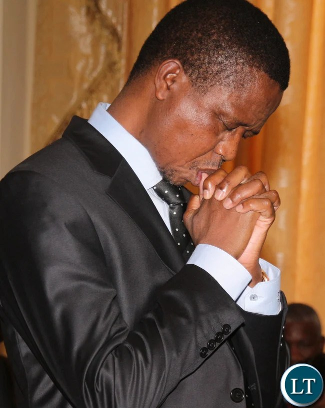 President Edgar Lungu praying
