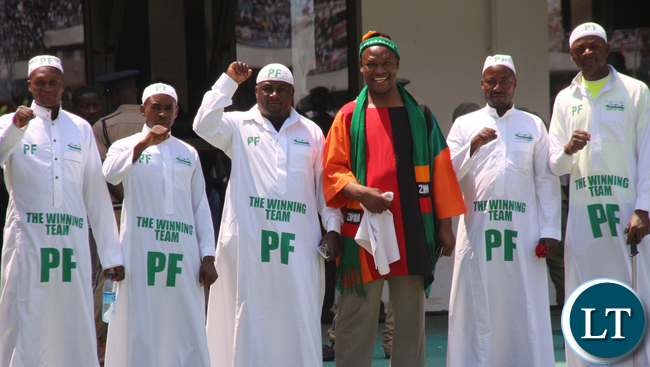 "ZASPOFA PAtron Peter Makembo joining a cheering ""Lungu team"" led by Ephraim Shakafuswa."