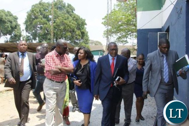 Lawyer Mushipe (in blue) after leaving Woodlands Police