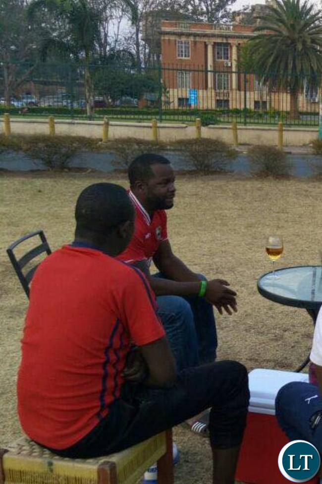 PF member Maxwell Chongo in deep conversation with his fellow PF youths outside the Supreme Court grounds